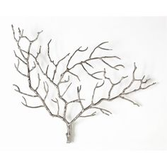 The metal tree sculpture by Arteriors elegantly showcases the simple beauty of nature. Finished in polished nickel, this transitional accent piece fills a wall with its outstretched branches.