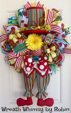 Circus Clown Deco Mesh Wreath with Clown Legs, Top Hat & Light Up Miniature Ticket Booth, Circus Decor, Birthday Party Decor, Carnival Decor by WreathWhimsybyRobin on Etsy Deco Mesh Crafts, Wreath Crafts, Diy Wreath, Wreath Ideas, Circus Decorations, Circus Clown, Circus Party, Circus Theme, Deco Mesh Wreaths