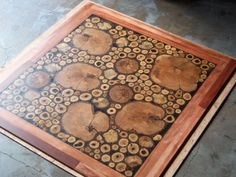 Check out this awesome flooring made from rounds of a fallen tree.