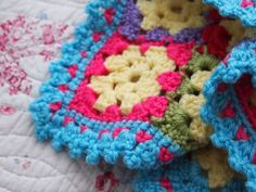 yarnaway: a crochet scrapbook: little heart granny square blanket made with Bernat, Vanna's Choice and Caron Simply Soft colors. So sweet!