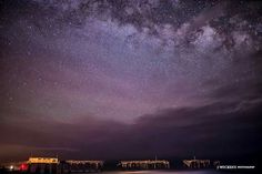 "Outer Banks NC Local Artists Facebook post---Fine Art America---""High Above the Earth"", Milky Way sliding past Frisco Pier.  Photographer credit: J Wickens Photography."