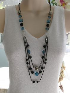 Hey, I found this really awesome Etsy listing at http://www.etsy.com/listing/159671992/multistrand-black-and-blue-necklace