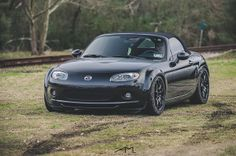 One day I'll have another Mazda MX-5... Love the mean stance + rollbar.