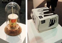 McDonalds packaging-inspired art, cup at left, artist unknown; box at right, painted bronze by Tom Sachs