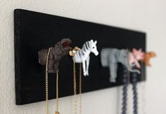 Animal Jewelry Holder | 30 Clever Ways to Keep Your Jewelry Organized. Cute pegs in kids room with cheap DG toys. Good idea other repurposed stuff