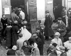 People in a ghetto street. The Warsaw Ghetto. The picture is the courtesy of Yad Vashem.