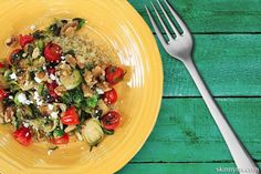 Brussels Sprouts and Cherry Tomato Saute with Goat Cheese and Walnuts. I think I'd prefer feta cheese..either way, sounds yummy!