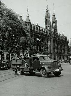 May 15, 1940. After capitulation of the Dutch armed forces German troops occupy Amsterdam. In the photo: German army truck with soldiers on the Nieuwezijds Voorburgwal. In the background the main post office. #amsterdam #worldwar2