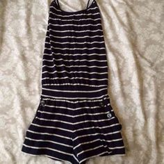 Cute F21 Romper Worn one time but in great condition. Cute button details on sides of pockets Forever 21 Dresses