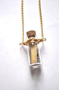 Imagine in a glass bottle necklace : )