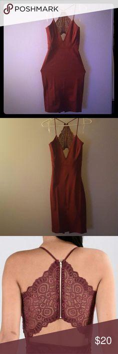 Burgundy Bodycon Dress Spaghetti strap burgundy dress. Knee length. Also has a slit on the back. Dresses
