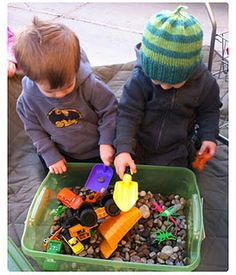 Great gift for boys! Construction box, complete with plastic bugs, trucks/tractors, shovels, rocks...personalized label! SO cute!