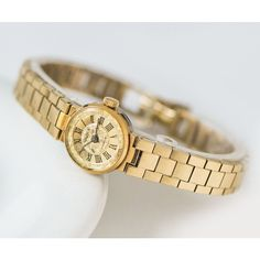 Gold plated lady's watch bracelet Seagull, cocktail watch women's... (€90) via Polyvore featuring jewelry, holiday jewelry, gold jewellery, yellow gold jewelry, cocktail jewelry and petite jewelry