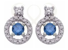 18 KT white gold earrings with a blue diamond and colorless diamonds.