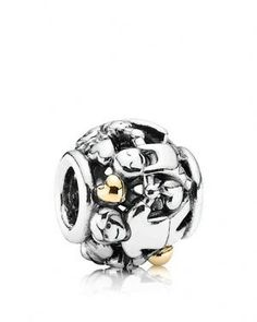 A sentimental Pandora charm with rich detailing in sterling silver with 14K gold…