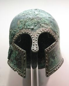 """Corinthian bronze helmet with an inscription reading: """"Miltiades dedicated to Zeus"""" - Miltiades was the general who led the Athenians at the battle of Marathon and defeated the Persians - Olympia Museum, Greece"""
