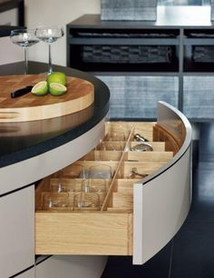 Smallbone Kitchens--don't love the curve, but love the drawer cubbies.