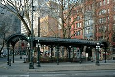 Klondike Gold Rush National Historical Park - Pioneer Square National Historic District, Seattle, Washington - In addition to the totem pole, a wrought-iron Victorian pergola and a bust of Chief Seattle were added to the park in 1909. The Pergola was a Yesler Way street car stop