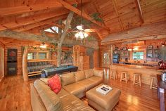 Thie Tree House Cabin captures the imagination with all its artistic touches, fitting for being located in the Gatlinburg Arts and Crafts Community. From the moment you are at the front door you will discover that local artisans played a big part in the creation of this log cabin. Enter the cabin through the hand-carved wood front door.  A massive man made tree runs throughout the cabin. Gatlinburg/Pigeon Forge.