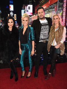Demi Lovato (left), Carrie Underwood, Luke Bryan and Caroline Boyer pose at the Dick Clark's New Year's Rockin' Eve with Ryan Seacrest on Dec. 31, 2015, in New York City.