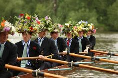 The Procession of the Boats at Eton College in England. The rowing team is getting ready to start the race.