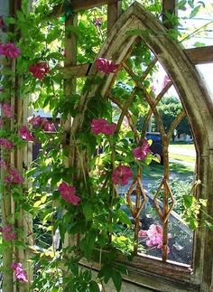 Add an old ornate window to a garden trellis.