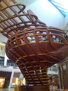 This amazing structure in the middle of a shopping mall is a restaurant Compare restaurant size to store fronts to get an idea of its enormity.