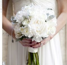 an all-white bouquet of roses.