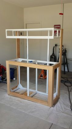 Aquarium stand. I could just build a wood stand to go around my metal frame...hmm...