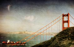 Golden Gate with boat and cityscape