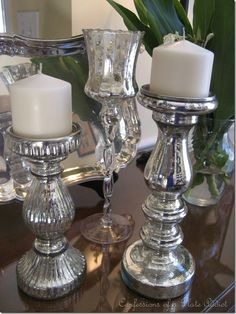 Solid silver-colored candlesticks from Goodwill transformed into mercury glass -- DIY tutorial