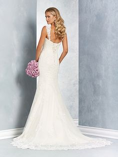 A romantic wedding dress with a sweetheart neckline, detachable straps, flared skirt, and chapel train.