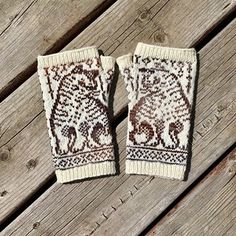 These fingerless mitts are knit with fingering weight yarn in two colors - approximately 165 yds/150m of the main color and 75 yds/70m in a contrasting color.