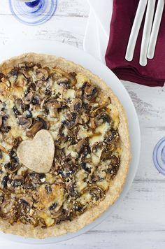 Caramelized onion and mushroom tart! The perfect vegetarian appetizer, side or main dish. Whole wheat tart stuffed with onions, mushrooms, and gorgonzola cheese.  | www.delishknowledge.com