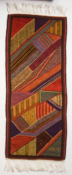 Use favorite colors & noodle scraps for this Geometric stripes wool table runner for cedar chest top