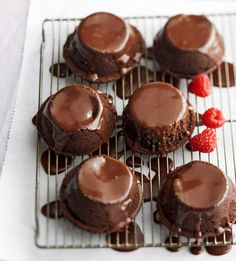 Daily Dish: These Dark Chocolate-Raspberry Cakes are filled with fresh raspberries and drenched in creamy chocolate icing. Get more Daily Dish recipes here: http://bhgfood.tumblr.com/