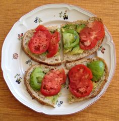 Smashed avocado and heirloom tomatoes with a sprinkling of chili flakes on whole wheat sourdough bread.   Delicious!