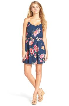 Free shipping and returns on EVERLY Floral Print Strap Back Skater Dress at Nordstrom.com. Vivacious watercolor blossoms drift down a flowing, free-spirited skater dress styled with a relaxed fit and narrow bar detail streaking across the open back.