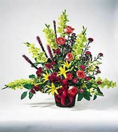 This colorful bouquet conveys your deep sympathies. Traditionally arranged in a basket are red roses, pink gladiolus, seasonal flowers, and more. Appropriate to send to a residence, funeral home, or memorial service.