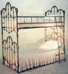 Wrought iron bunk bed. I have never seen anything like this before.