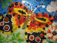 Mosaic art with plastic bottle caps by Michelle Stitzlein.