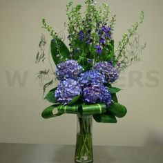 W Flowers product: Tall Vase Arrangement with Purple Flowers
