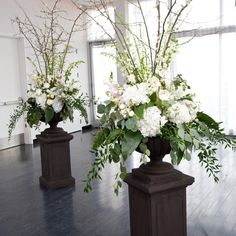 Use the white columns with giant bouquets of red roses on each.