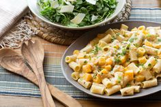 Goat Cheese & Butternut Squash Pasta with Arugula & Shaved Parmesan Salad- a larger squash & more onions are recommended by reviewers