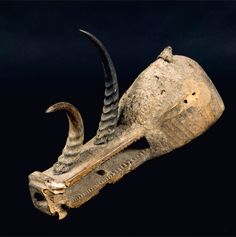 Africa | Helmet mask from the 'komo' society of the Bamana people of Mali | Wood, antelope horns, iron nails, crusty mud patina