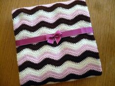 Neopolitan Ripple crochet blanket. Made this for a friend's baby. The pattern that is linked within the blog that this is on has a better photo tutorial. I thought the blanket should have been narrower and much much shorter than called for in the pattern, but once you get the gist of it, it's easy to modify. It turned out beautifully.
