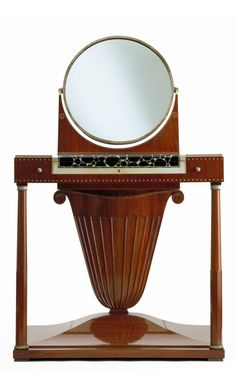 Jacques-Emile Ruhlmann, Lotus dressing table, 1919-23. Oak and mahogany with amaranth and andaman padouk veneer; ebony and ivory inlays; silvered bronze mirror frame and fittings; mirrored glass.