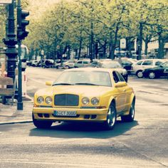 CARS - I spotted this yellow (!) Bentley a while back in Berlin, Germany. Who knows the exact type of this... - http://lesvoitures.fr/i-spotted-this-yellow-bentley-a-while-back-in-berlin-germany-who-knows-the-exact-type-of-this/