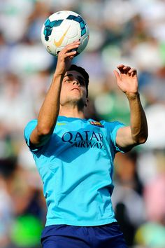 Marc Bartra of FC Barcelona juggles the ball during the warm up prior to the La Liga match between Elche FC and FC Barcelona at Estadio Manuel Martinez Valero on May 11, 2014 in Elche, Spain.