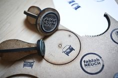 This is a great idea to make your own brand stamp. Delrin is an excellent substrate for this. You can find it here: http://www.laserbits.com/stamp-products/delrin-sheet/aus-100-delrin-sheet-white.html